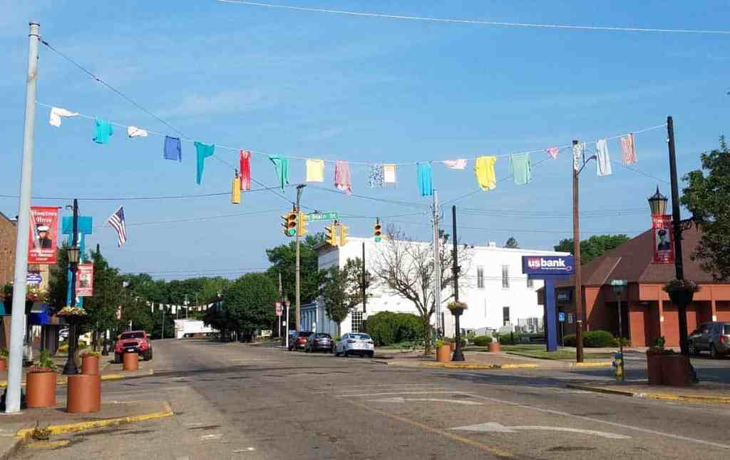 Logan Ohio Washboard Festival decorations hanging across Main Street. We came to town to see the Paul A Johnson Pencil Sharpener Museum.