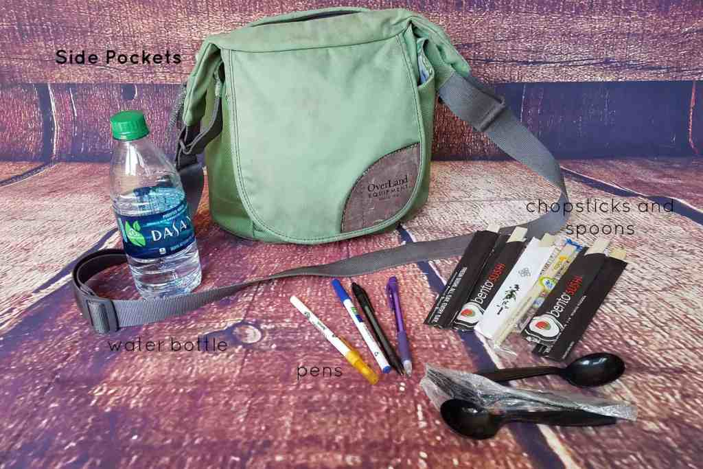 20 Days of Me - Day 5 - What's in your purse? An ecclectic collection from my side pockets include a water bottle, pens, chopsticks, and plastic utensils.
