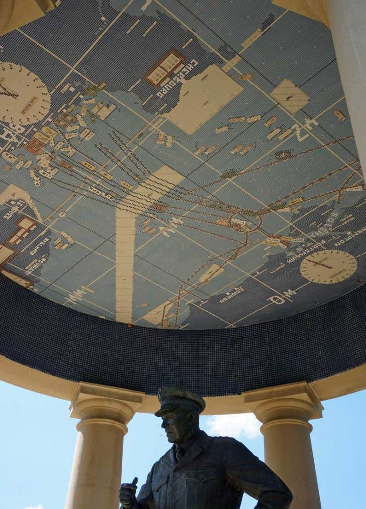The mosaic lining the ceiling of the gazebo shows the invasion plan while a statue of General Eisenhower, the supreme commander of Allied Expeditionary Forces in World War II, stands below looking out over the National D-Day Memorial towards the Overlord Arch.