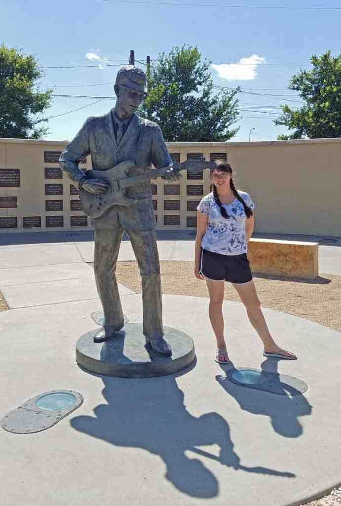 Standing next to the statue of Buddy Holly at the West Texas Hall of Fame