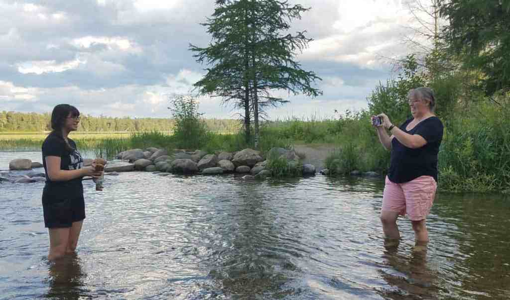 taking pictures at the Mississippi River Headwaters at Itasca State Park