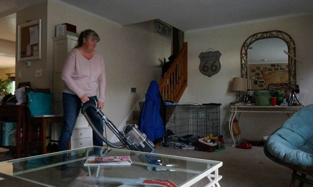 using a vacuum in the living room