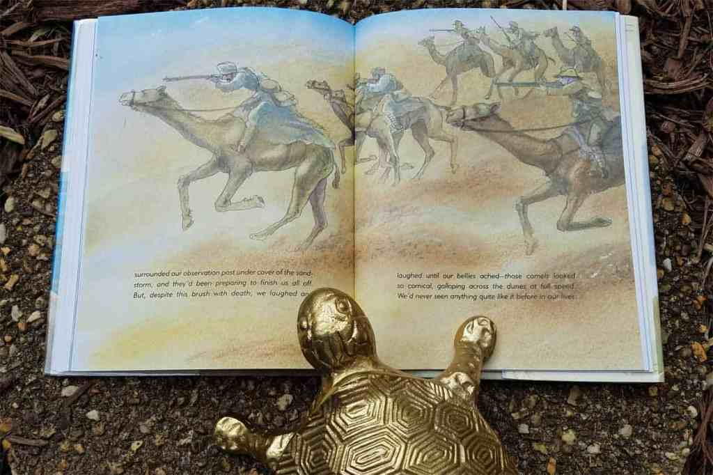 Inside page of The Tortoise and the Soldier showing camels, carrying soldiers, running across the desert sand