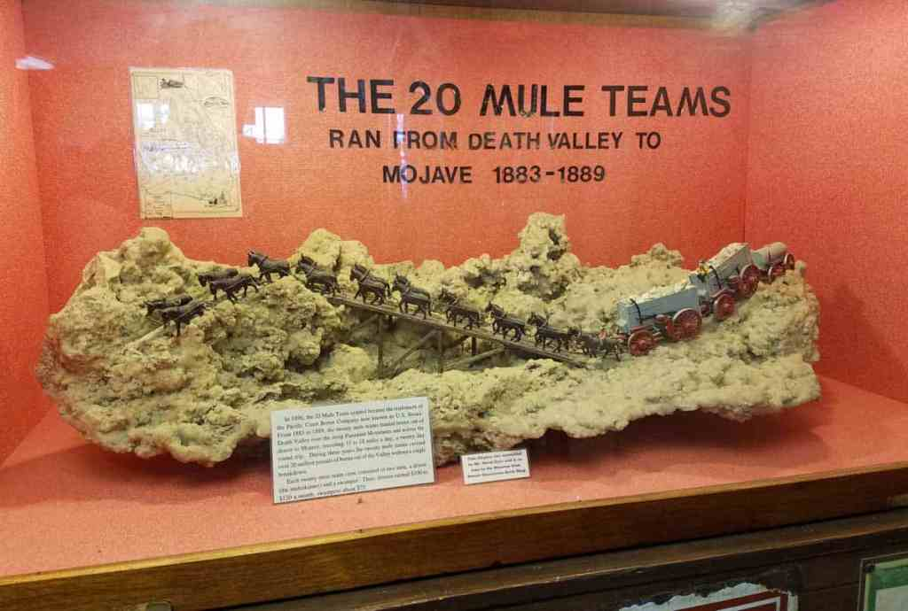 model of a twenty mule train team displayed on a large rock crystal to represent travel across the desert and mountains