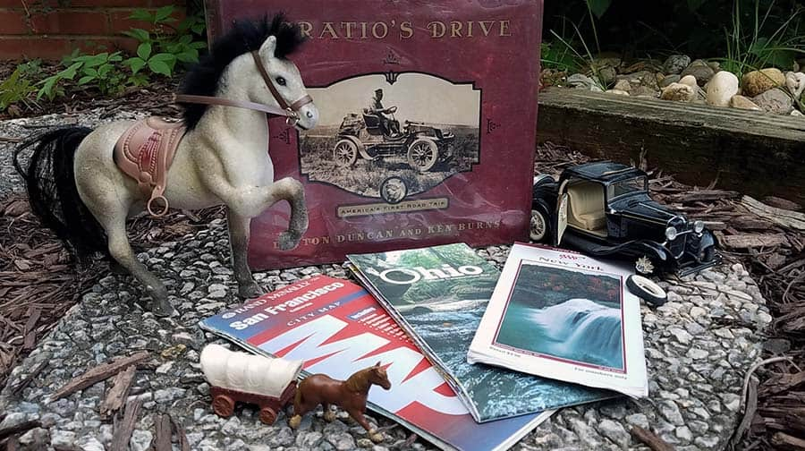 Cover of book Horatio's Drive with road maps, an old model car, and a toy horse