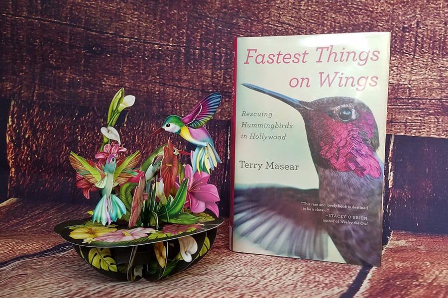 Fastest Things on Wings book next to a 3-D greeting card depicting hummingbirds and flowers
