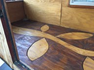 The custom floor with the two color stain.