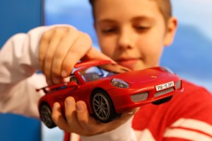 "Boy looks at ""Porsche"" car of company Playmobil during press preview of International Toy Fair in Nuremberg"