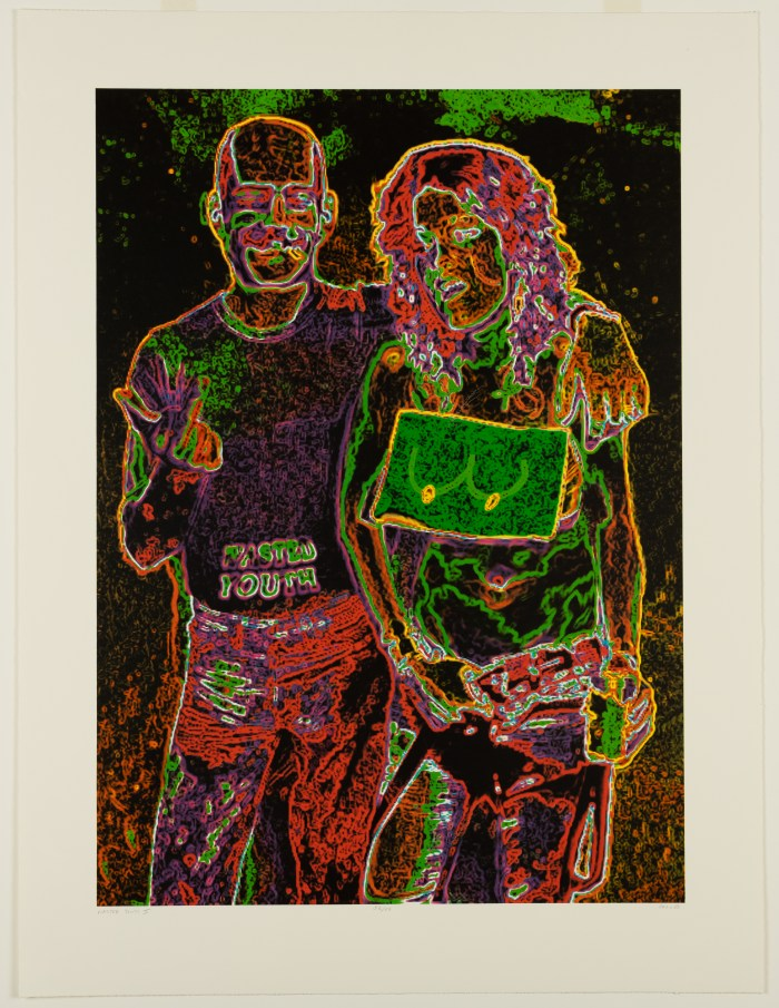 Negative image with neon colors depicting two casually clothed figures standing close to one another
