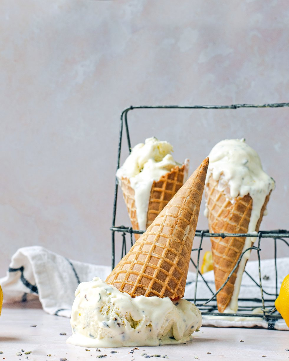 Lemon lavender no churn ice cream placed in waffle cones.  One tipped over.