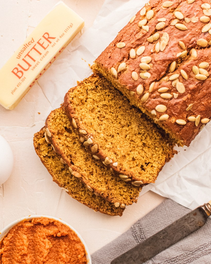 The overhead photo of sliced pumpkin bread demonstrates the texture of the crumb.