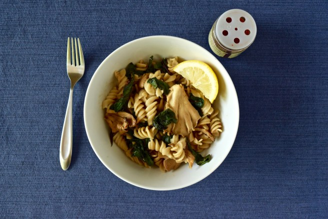 Mushroom Pasta with Swiss Chard | This delicious recipe is gluten free, dairy free and vegetarian. It serves about 4 people as an entree or 6-8 as a side dish and can be made in just 20 minutes. It's creamy and has so many layers of flavor. You must try it!