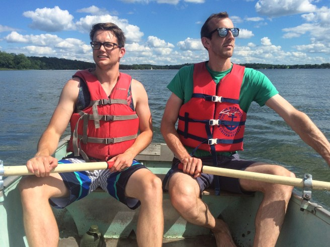 Tips for Easy Camping Dinners | Alex Skjong and Eric D. Johnson rowing a boat on Lake Andrew in Sibley State Park