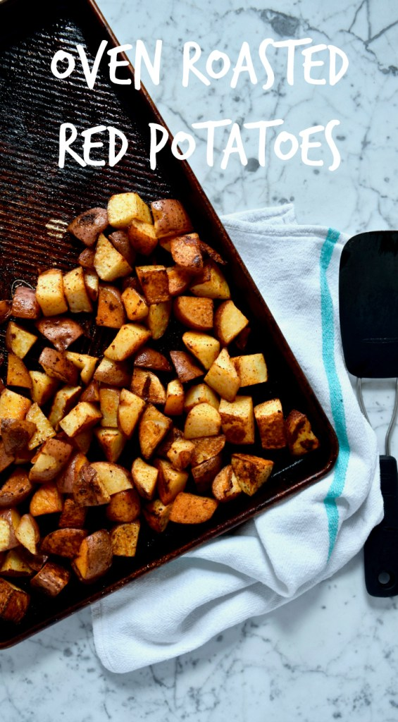 Oven Roasted Red Potatoes - This is a super easy way to make potatoes for breakfast, in a lunch bowl or as a side with dinner. They're seasoned simply with paprika, onion powder, garlic powder, salt + pepper. Delicious!