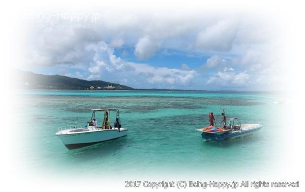 サイパンの美しい海に浮かぶ船の思い出写真