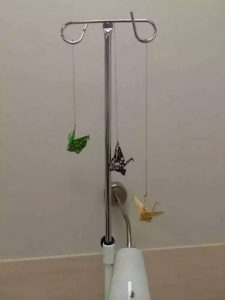 Origami cranes hanging from IV stand