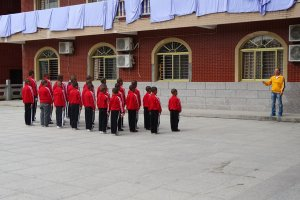Group of Chinese Shaolin Kung Fu students lined up for a lecture