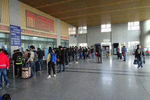 People queuing for tickets at a Chinese train station