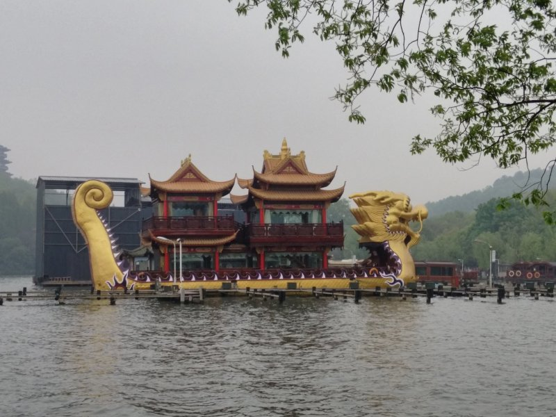 A big dragon boat floating in the lake