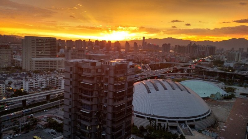 Sunset from our apartment on 26th floor in Jimei, Xiamen.