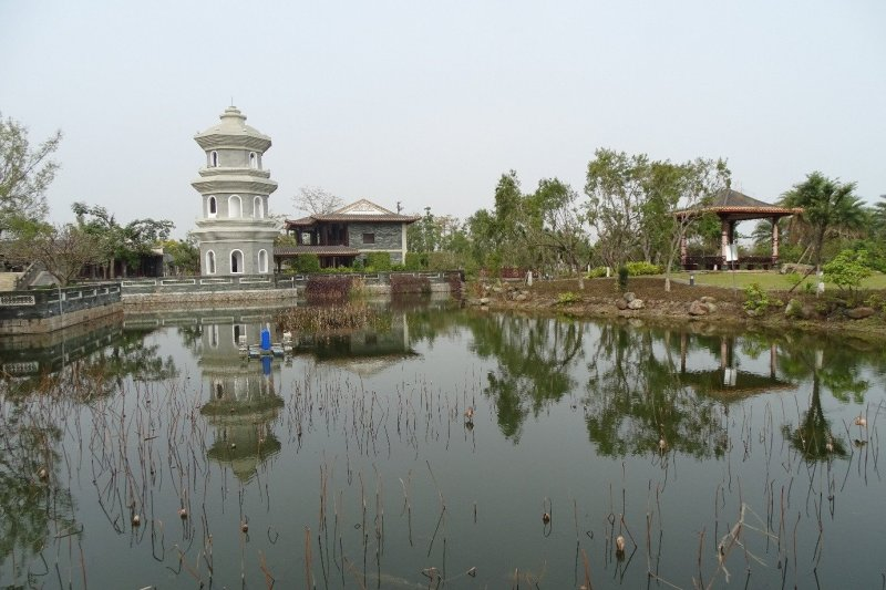 A small pond with pagoda and a small tower in Jimei, Xiamen.