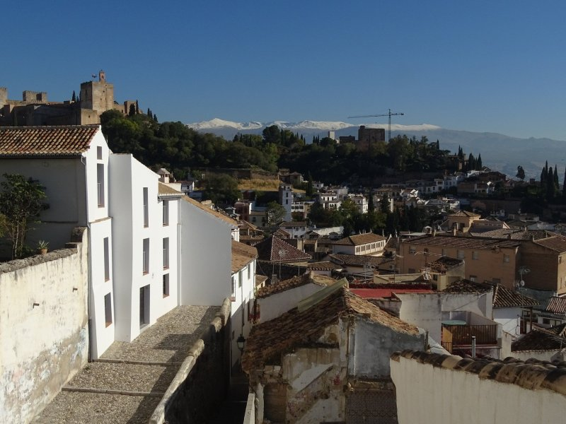 View from Abaco Te. You can see a street of the Albaicin as well as the Alhambra and snowcapped Sierra Nevada in the background