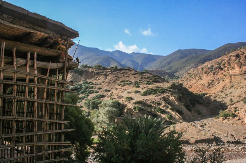 Berber house with rickety wooden frame and view of mountains beyond