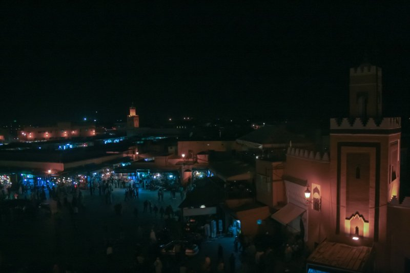 Jemma Al Fna night view, mosque can be seen in foreground