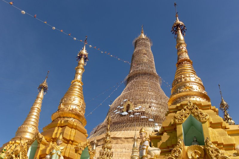View looking up at Shwedagon Paya and 3 foreground pagodas