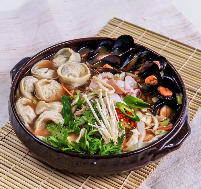 A Korean seafood stew with dumplings, mushrooms, chillis, muscles and herbs.