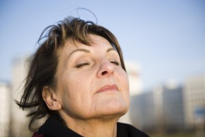 Woman breathing in deeply and relaxing