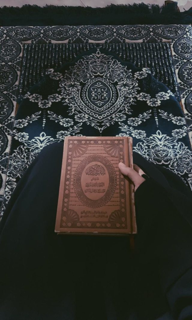 Muslim woman with Quran in her hands - (Credit: Majdah Nizam)