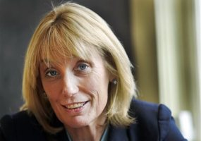 Gov. Maggie Hassan, D-N.H., poses at the governors mansion, Bridges House, Monday, Oct. 5, 2015, in Concord, N.H. Hassan announced Monday she will seek the nomination for U.S. Senate. Hassan will try to unseat Republican Kelly Ayotte. (AP Photo/Jim Cole)