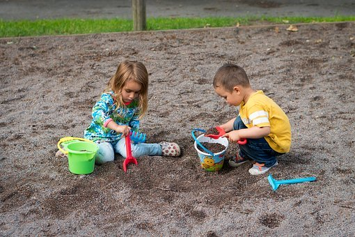 kids playing outdoor in sand