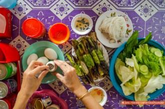 Peeling pong tia koun (boiled baby duck eggs), Battambang.