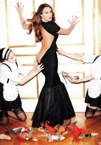 Tamara Ecclestone strikes a cheeky pose with two French maids