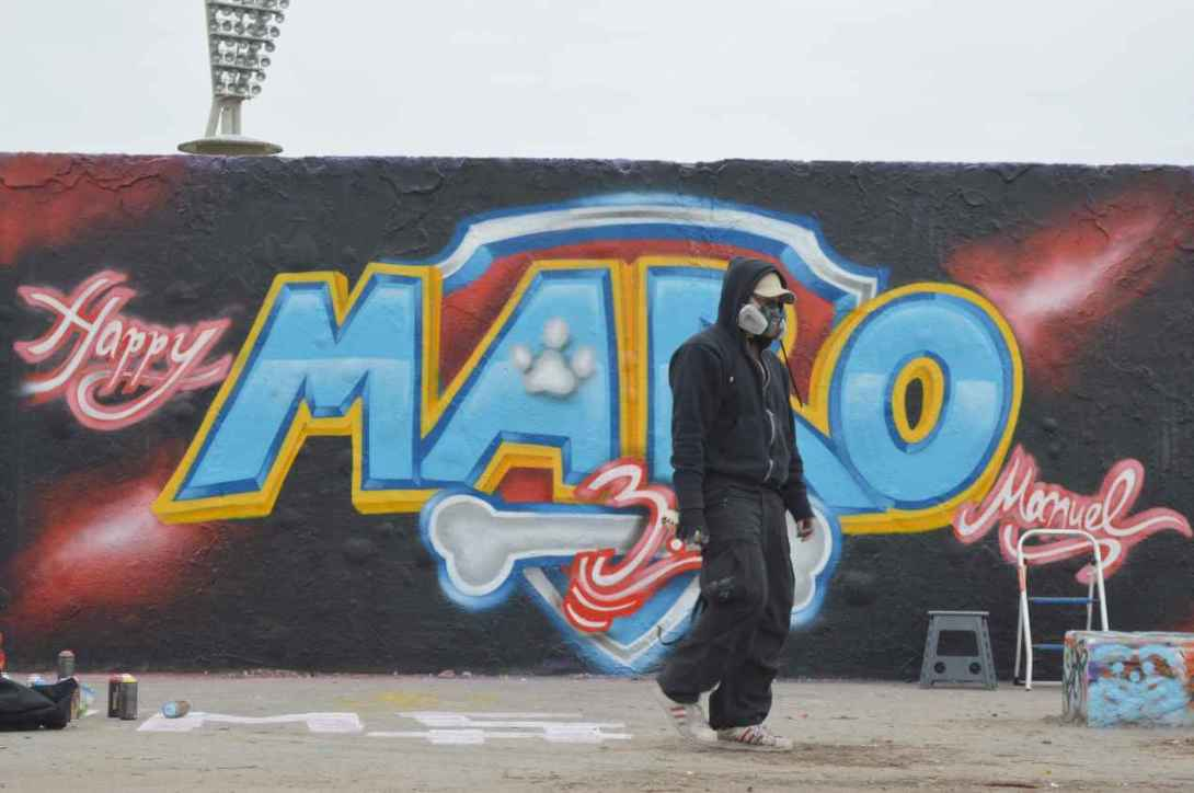 Man at work Grafitti in Berlin