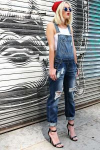 Baggy overalls with distressing and rips down the front. Pockets on the front and back. Button c ...