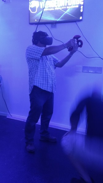 Shooting virtual zombies.
