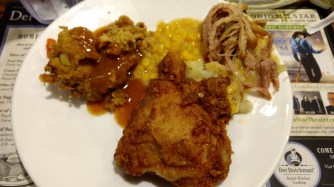 Broasted Chicken with some pulled pork and stuffing with gravy.