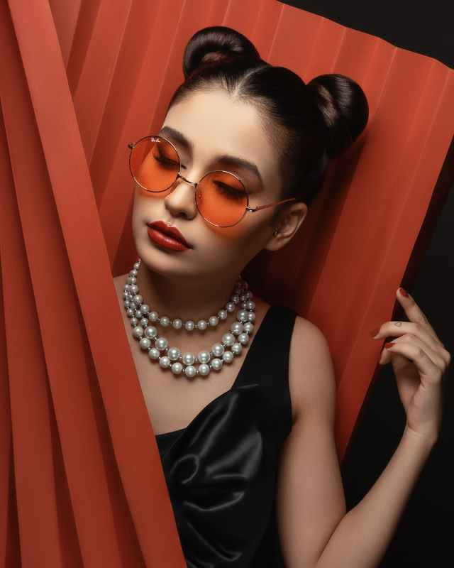 photo of woman in sunglasses posing with her eyes closed