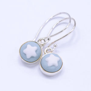 Star, a small earring design in light blue, made from porcelain and sterling silver