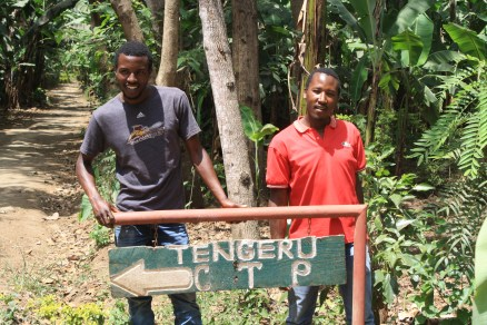 Our guides with the Tengeru Cultural Tourism Program sign
