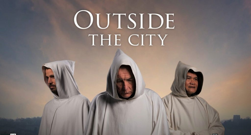 Three white-hooded Cistercian monks from Mount. St Bernard, UK