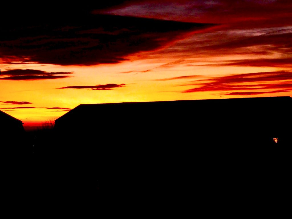 Red and orange sunset over Welsh hills
