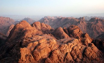 Mount Sinai or Mount Zion where is God today