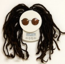Self portrait day of the dead (found objects, includind the artist's hair)