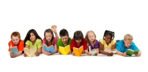 A group of diverse children reading a magazine.