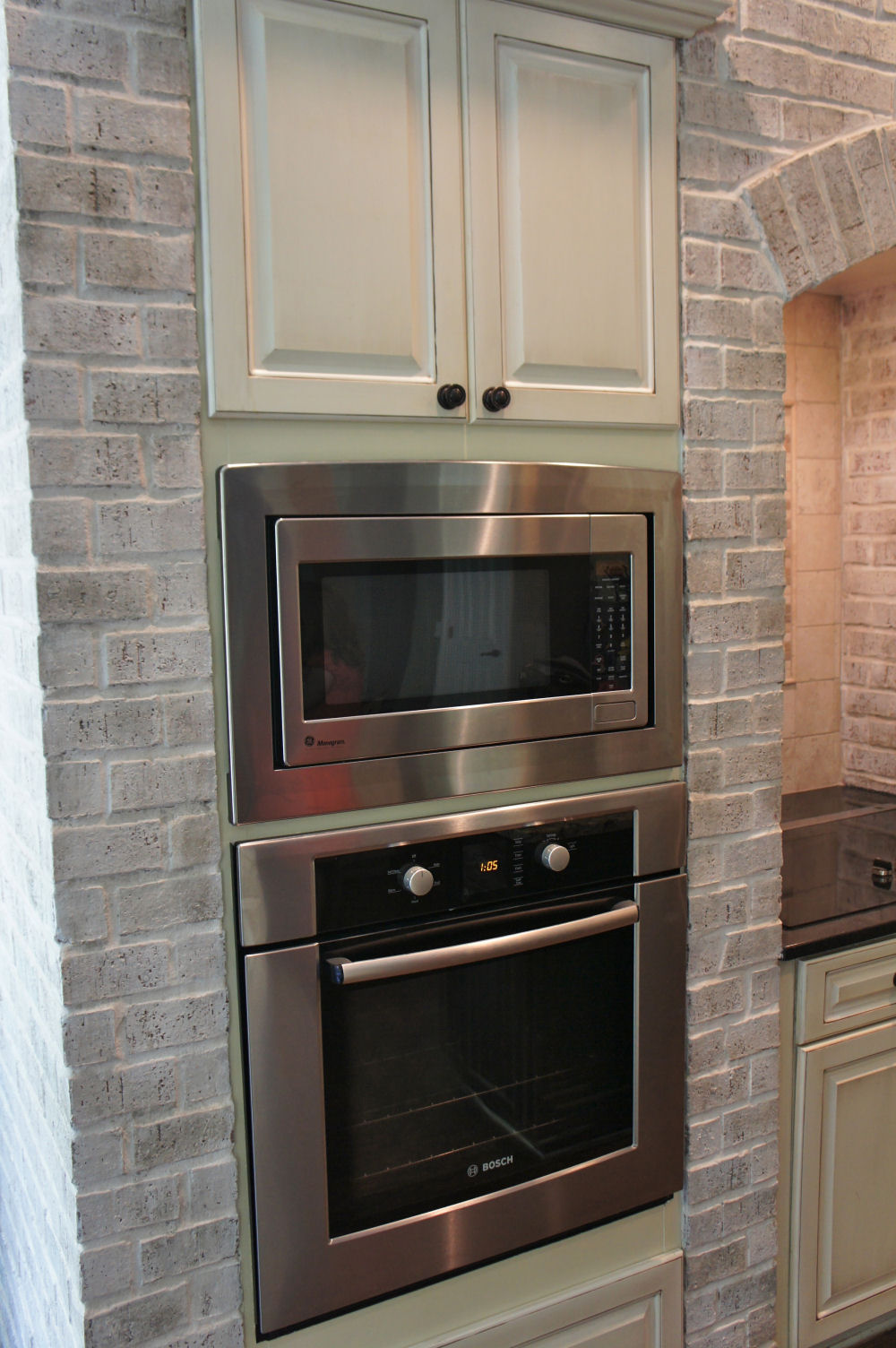 Painting Kitchen Cabinets and brick lighten up a kitchen