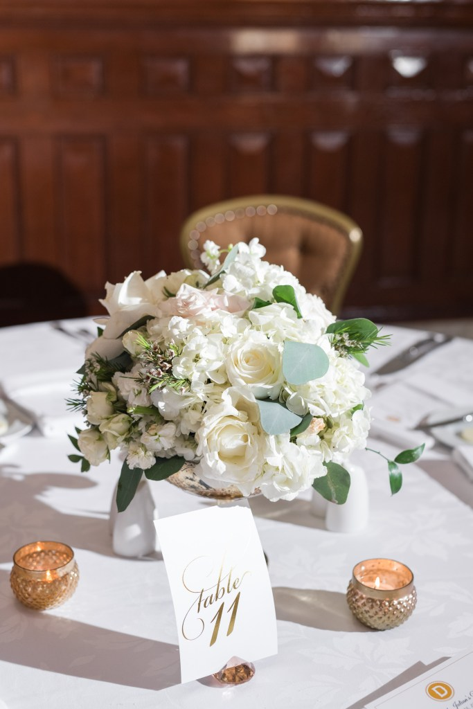 A breathtaking lush arrangement that captures the beauty of this timeless spring wedding.